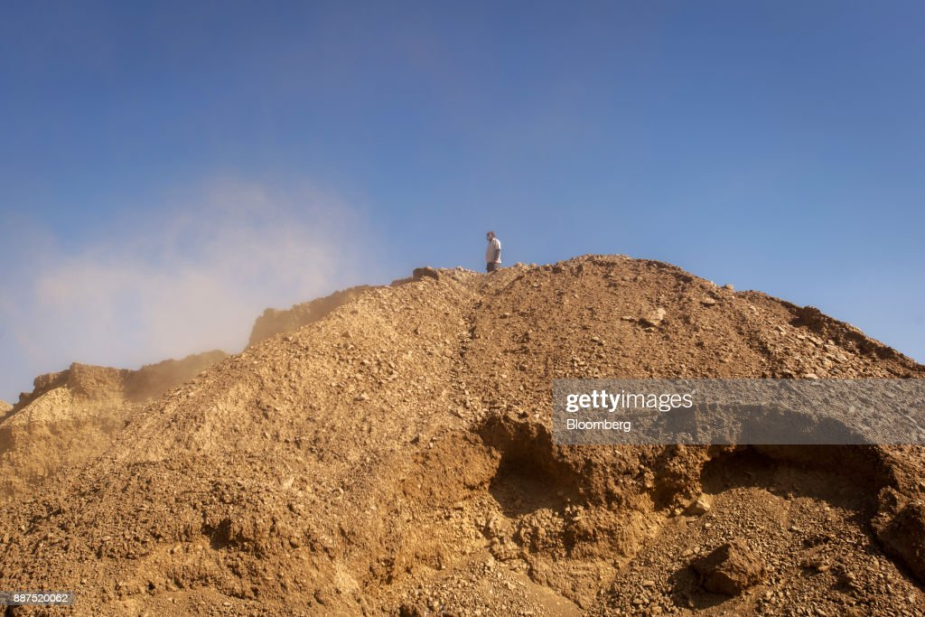 An employee stands atop a pile of clay in a preparation unit at the Shabbir Tiles & Ceramics Ltd. production facility in Karachi, Pakistan, on Wednesday, Dec. 6, 2017. Shabbir, which had suffered four years of losses while fighting to compete with cheap imports from neighboring China, is on course to post an annual profit next financial year after Pakistan placed an anti-dumping duty on Chinese tiles in October. That follows similar moves from the regulator on steel products. Photographer: Asim Hafeez/Bloomberg via Getty Images