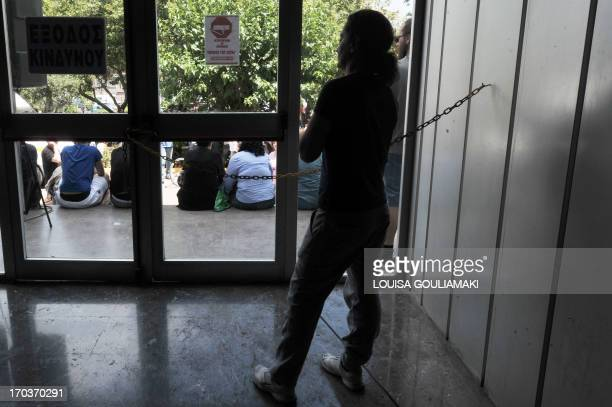 An employee stands inside the Greek state broadcaster headquarters in Athens on June 12 2013Greek political parties and unions battle to reverse the...