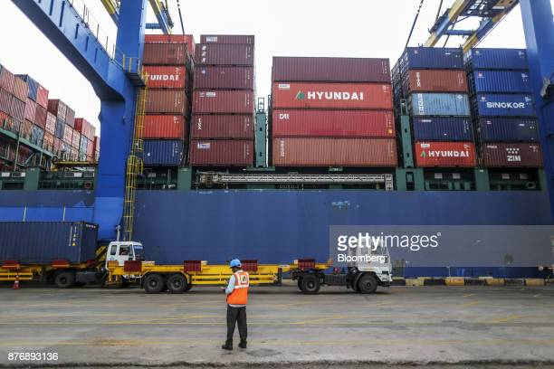 An employee stands near a container ship at Krishnapatnam Port in Krishnapatnam Andhra Pradesh India on Friday Aug 11 2017 Growth in gross domestic...