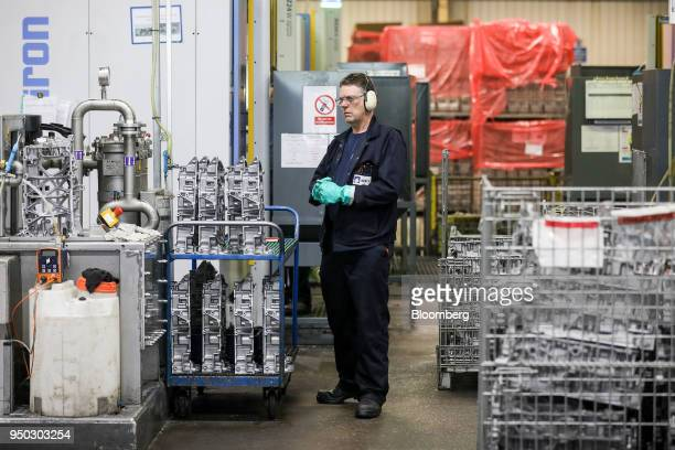 An employee stands near a cutting machine for panther ladder frames at Liberty Aluminium Technologies in Coventry UK on Monday April 23 2018 Aluminum...