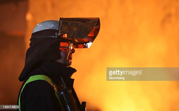 An employee stands next to the blast furnace at the Sahaviriya Steel Industries Pcl steelmaking plant in Redcar UK on Tuesday May 29 2012 Thailand's...