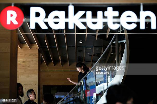 An employee stands on a flight of stairs inside the Rakuten Cafe operated by Rakuten Inc in Tokyo Japan on Thursday May 29 2014 Japan's retail sales...