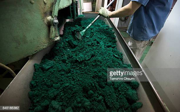 An employee stirs ingredients of mosquito coils on the production line at the Kishu Factory of Dainihon Jochugiku Co Ltd on July 6 2016 in Arita...