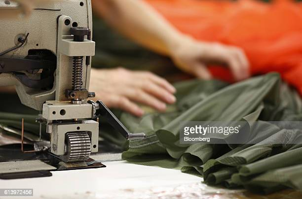 An employee stitches a parachute canopy at the Mills Manufacturing Corp facility in Asheville North Carolina US on Wednesday Oct 5 2016 Mills...
