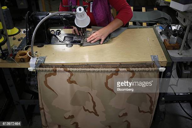 An employee stitches a reserve parachute canopy bag at the Mills Manufacturing Corp facility in Asheville North Carolina US on Wednesday Oct 5 2016...