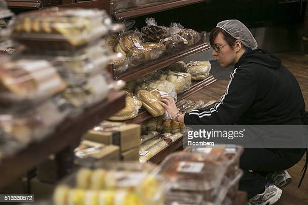 An employee stocks bakery items at a Kroger Co grocery store in Birmingham Michigan US on Tuesday March 1 2016 Kroger Co is scheduled to release...