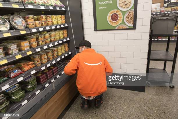 An employee stocks shelves at the Amazon Go store in Seattle Washington US on Wednesday Jan 17 2018 After more than a year of testing with an...