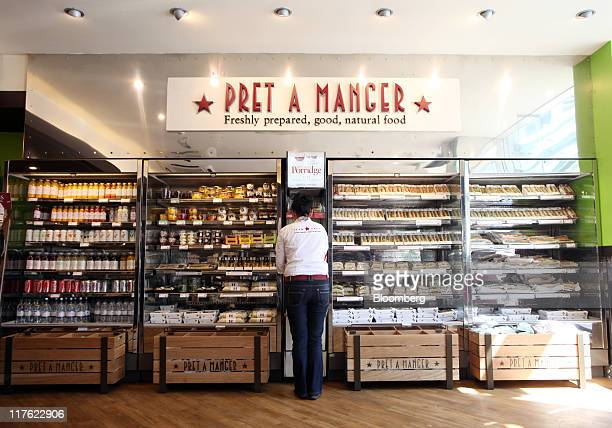 An employee stocks shelves with food for sale at a Pret A Manger restaurant in London UK on Wednesday June 29 2011 Pret A Manger a closely held UK...