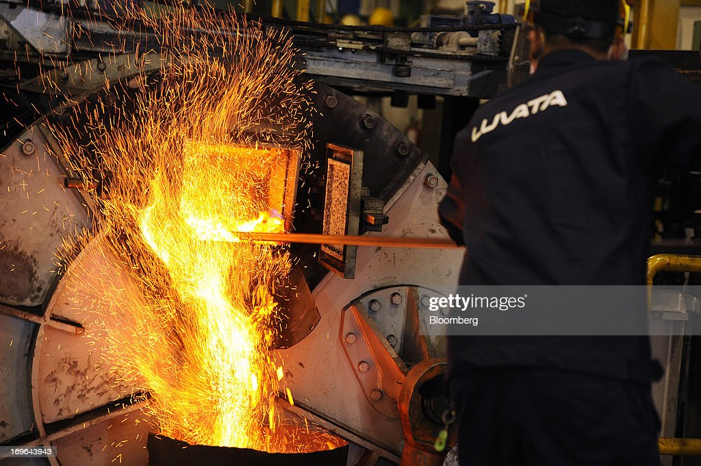 An employee stokes a furnace as cubes of shredded scrap copper are fed into it at the Luvata Malaysia Bhd. plant in Pasir Gudang, Johor, Malaysia, on Monday, May 13, 2013. At a time when copper stockpiles are rising to the highest in a decade, manufacturers are paying the biggest premiums for the metal in as much as seven years as financing deals lock up supply and extend lines at warehouses. Photographer: Munshi Ahmed/Bloomberg via Getty Images