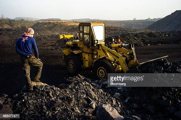 An employee supervises a loader collecting coal at the Goladi coal depot operated by Coal India Ltd subsidiary Bharat Coking Coal Ltd in Jharia...