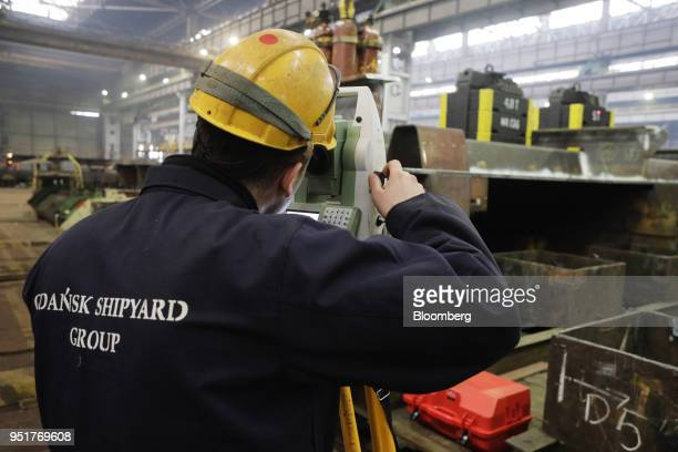 An employee takes levels readings as the factory prepares to manufacture wind turbine towers at the GSG Towers Sp. Z o.o. Factory, a unit of the...