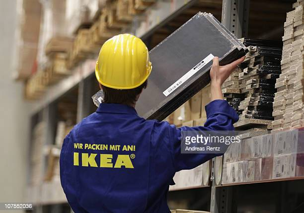 An employee takes out a parcel from a storage rack during a store opening at the fourth Ikea chain store in Berlin Lichtenberg on December 13 2010 in...