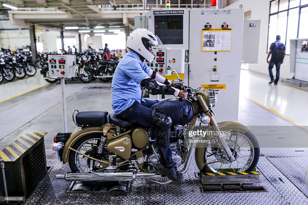 An employee tests a Royal Enfield Motors Ltd Classic 500 motorcycles at the company`s manufacturing facility in Chennai India on Tuesday July 14 2015.