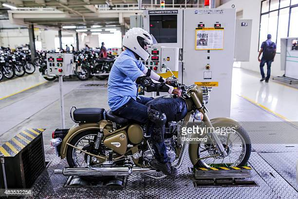 An employee tests a Royal Enfield Motors Ltd. Classic 500 motorcycles at the company's manufacturing facility in Chennai, India, on Tuesday, July 14,...