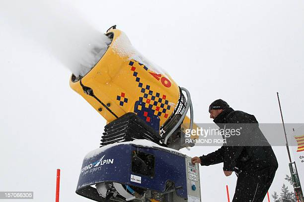 An employee tests a snow making machine on November 28 2012 at the FontRomeu ski resort in the French Pyrenees a few days before the the opening of...