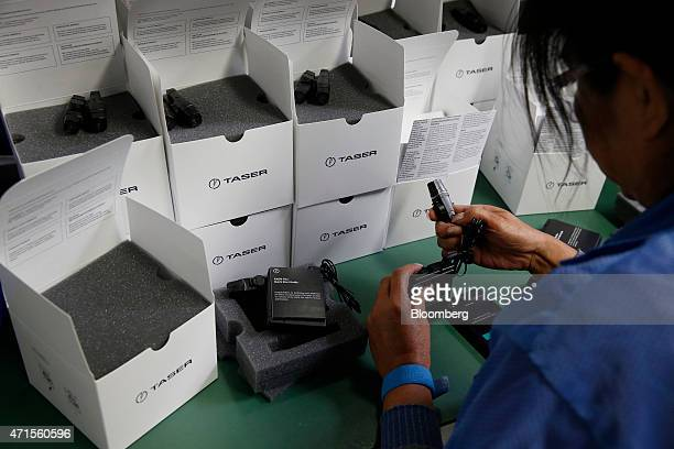 An employee tests and packages AXON police body cameras at the Taser International Inc manufacturing facility in Scottsdale Arizona US on Wednesday...