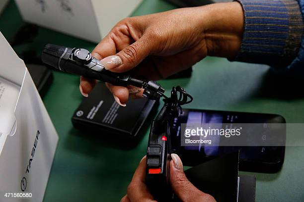An employee tests and packages the AXON police body cameras at the Taser International Inc manufacturing facility in Scottsdale Arizona US on...