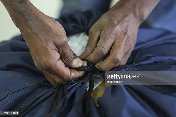 An employee ties a knot on a delivery bag at a Flipkart Online Services Pvt office in the Jayaprakash Narayan Nagar area of Bengaluru India on...