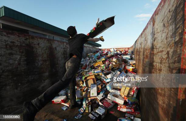 An employee tossed out damaged goods from an Acme supermarket into a dumpster following Superstorm Sandy on November 5 2012 in Long Beach Township...