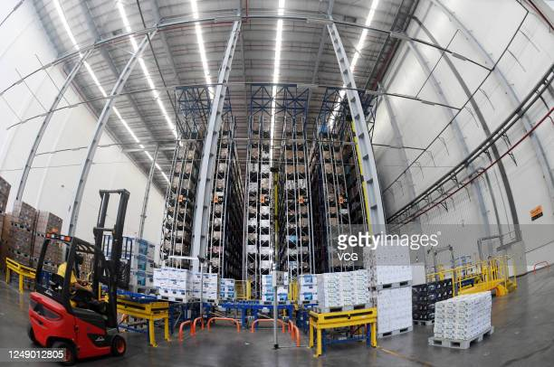 An employee transfers parcels at a logistic base of e-commerce giant Suning before the upcoming 618 Shopping Festival on June 11, 2020 in Nanjing,...