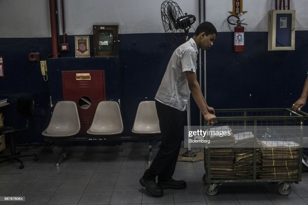 An employee transports documents inside a customs facility at the Port of Santos in Santos, Brazil, on Wednesday, Oct. 4, 2017. The port complex is a 3-square-mile microcosm of a country buffeted by political turmoil, drug-fueled violence and persistent income inequality as it emerges from a grinding recession. Photographer: Dado Galdieri/Bloomberg via Getty Images