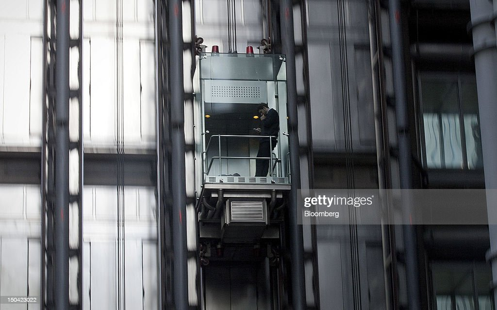 An employee travels in the lift at the Lloyds of London headquarters in London, U.K., on Friday, Aug. 17, 2012. Banks, insurers and other financial-services firms may eliminate a total of about 3,000 jobs across greater London as companies in the New York region add 9,000, according to U.K.-based researcher Oxford Economics Ltd. Photographer: Simon Dawson/Bloomberg via Getty Images