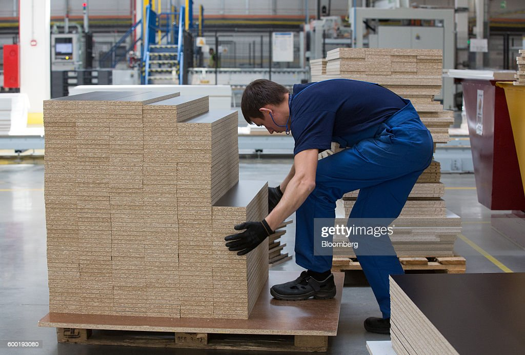 An Employee Unloads Wooden Furniture Slats Inside The New Ikea AB  Manufacturing Plant, In Velikiy