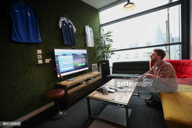 An employee uses a computer in a soccer themed meeting room at Fanduel Inc's offices in Edinburgh UK on Tuesday Feb 7 2017 More coders are choosing...
