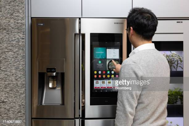 An employee uses a control panel on a Samsung Electronics Co smart refrigerator during a demonstration inside the Samsung CT Corp Raemian Internet of...