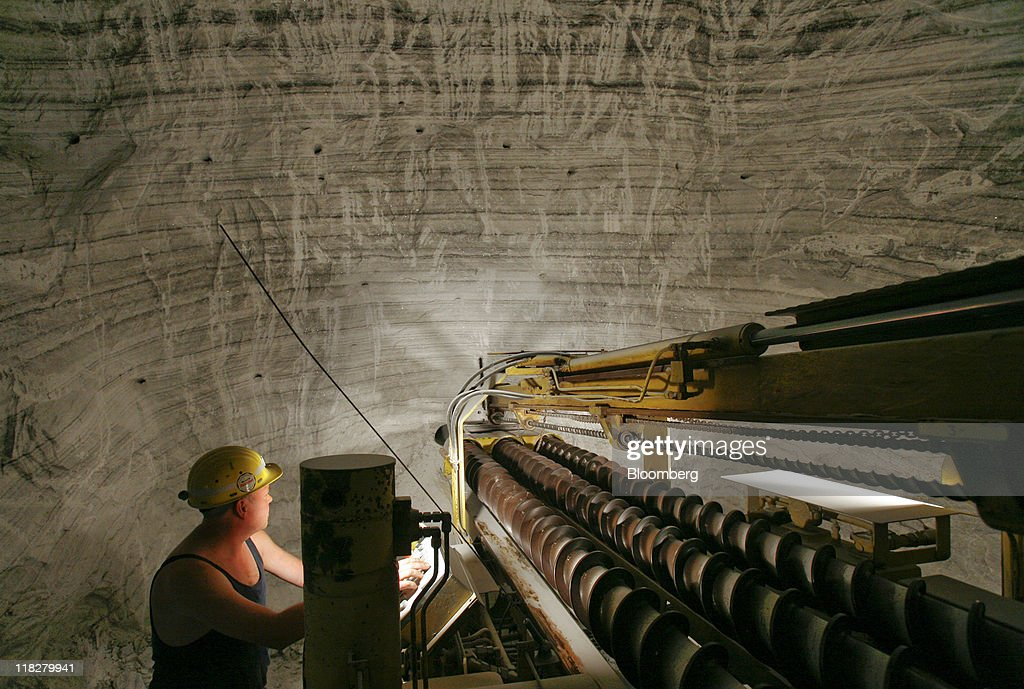 An employee uses a drilling machine to make blasting holes at the K+S AG potash mine in Unterbreizbach, Germany, on Tuesday, July 5, 2011. K+S AG, Europe's biggest potash producer, dropped 1.3 percent to 53 euros and Yara International ASA, the largest maker of nitrogen fertilizers, slid 4.2 percent to 303.70 kroner as a U.S. Department of Agriculture report showed that U.S. grain acreage and inventories topped analysts' estimates. Photographer: Hannelore Foerster/Bloomberg via Getty Images