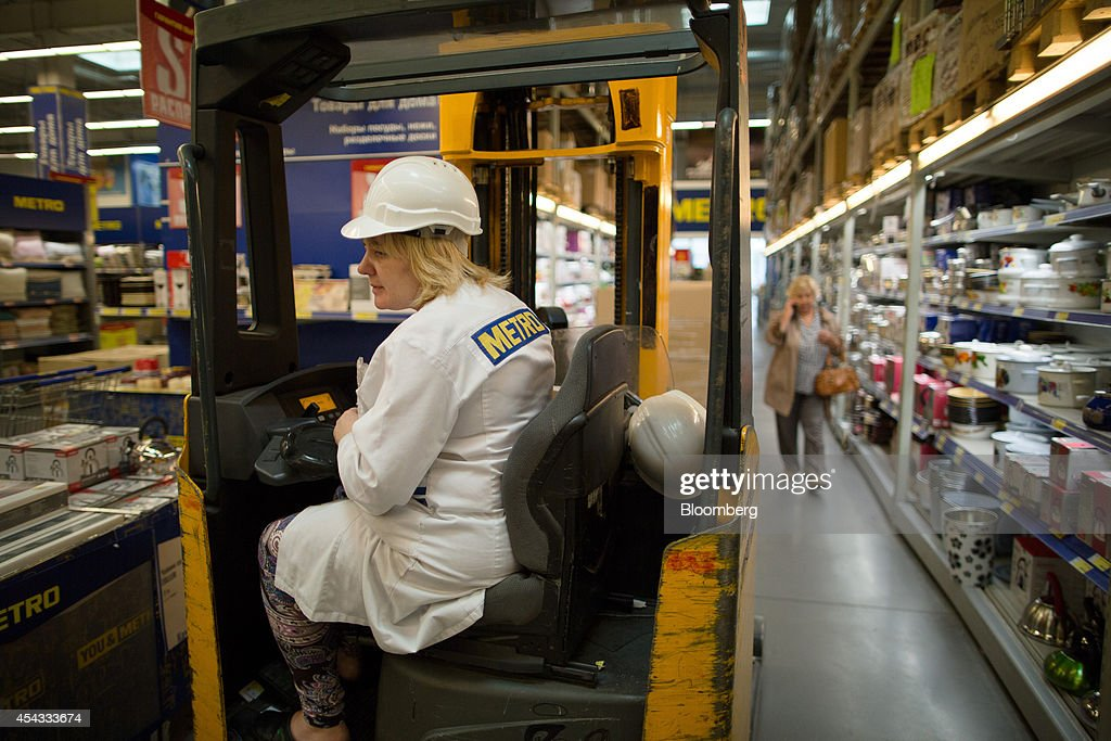 An employee uses a fork-lift truck to deliver products to the aisles inside a Metro Cash & Carry store, the Russia unit of Metro AG, in Moscow, Russia, on Friday, Aug. 29, 2014. Metro Cash & Carry has warned that domestic food suppliers are trying to increase some food prices as local produce is substituted for EU, Norwegian and U.S. equivalents which have been sanctioned. Photographer: Andrey Rudakov/Bloomberg via Getty Images