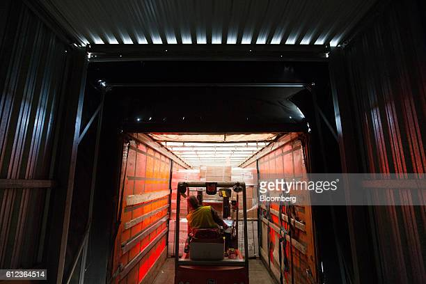 An employee uses a forklift truck to load goods into a distribution truck at the Ikea AB distribution center in Yesipovo village near Moscow on...