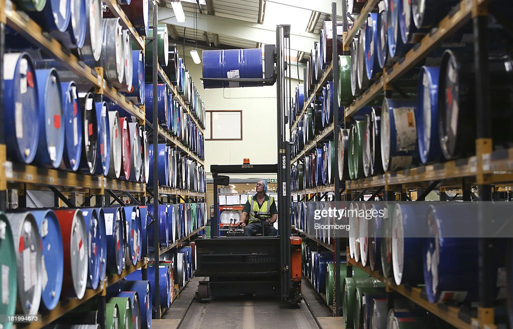 An employee uses a forklift truck to move a container drum of flavorings in the warehouse at the Treatt Plc factory in Bury St Edmunds, U.K., on Wednesday, Sept. 25, 2013. Treatt Plc, the U.K. supplier of mango oil to the Body Shop, is considering the biggest investment splurge in its 127-year history as Chief Executive Officer Daemmon Reeve seeks to unshackle the company from family owned traditions. Photographer: Chris Ratcliffe/Bloomberg via Getty Images