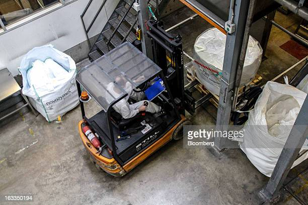 An employee uses a forklift truck to move a pallet loaded with a sack of granulated enzymes in the production facility at the headquarters of...