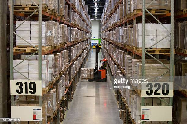 An employee uses a forklift truck to move goods in a storage aisle at the Ikea AB distribution center in Yesipovo village near Moscow on Monday Oct 3...