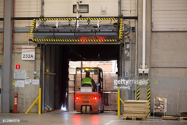 An employee uses a forklift truck to move goods into a distribution truck at the Ikea AB distribution center in Yesipovo village near Moscow on...
