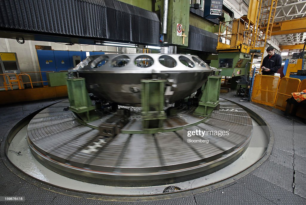 An employee uses a machine to inspect a combustion chamber during the manufacturing process at Ansaldo Energia SpA's power-plant production facility in Genoa, Italy, on Friday, Jan. 18, 2013. Finmeccanica SpA is seeking binding bids for assets, including a majority stake in Ansaldo Energia, by Jan. 23, while a final decision will be made at a later board meeting, Ansa reported Jan. 16. Photographer: Alessia Pierdomenico/Bloomberg via Getty Images