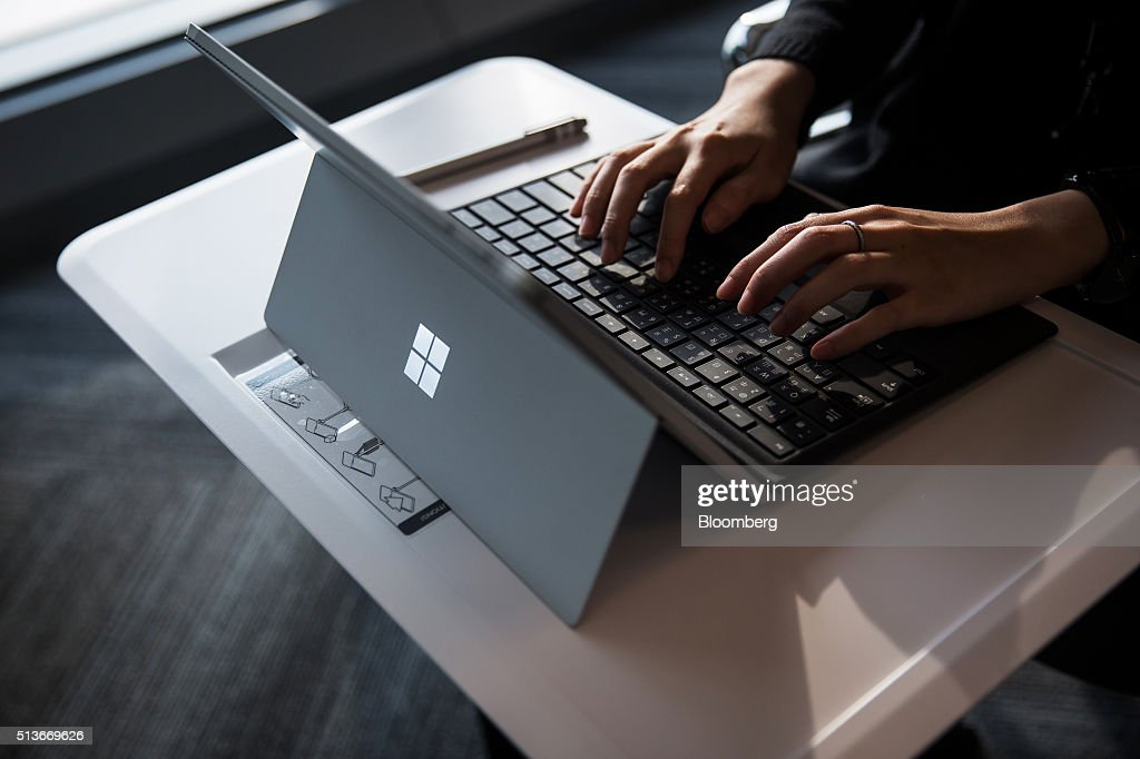 An employee uses a Microsoft Corp. Surface tablet computer at the company's Office and Experience Center during a media event for the opening of the workspace in Hong Kong, China, on Friday, March 4, 2016. Microsoft is rolling out a new service for its Windows 10 operating system to help large businesses detect hackers, security threats and unusual behavior on their networks, rivaling companies like FireEye Inc. and Symantec Corp. Photographer: Billy H.C. Kwok/Bloomberg via Getty Images