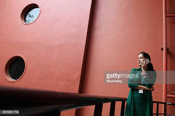 An employee uses a mobile phone at the Wipro Ltd headquarters in Bangalore India on Thursday April 14 2016 Wipro scheduled to release fourthquarter...