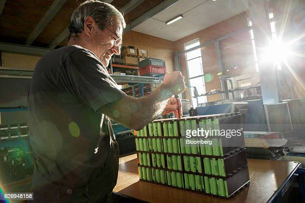 An employee uses a screwdriver to assemble a battery pack at the Johammer emobility GmbH electric motorbike factory in Bad Leonfelden Austria on...