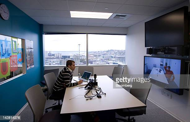 An employee uses the video conferencing room at Facebook Inc's new offices in Seattle Washington US on Thursday April 12 2012 Facebook Inc the...
