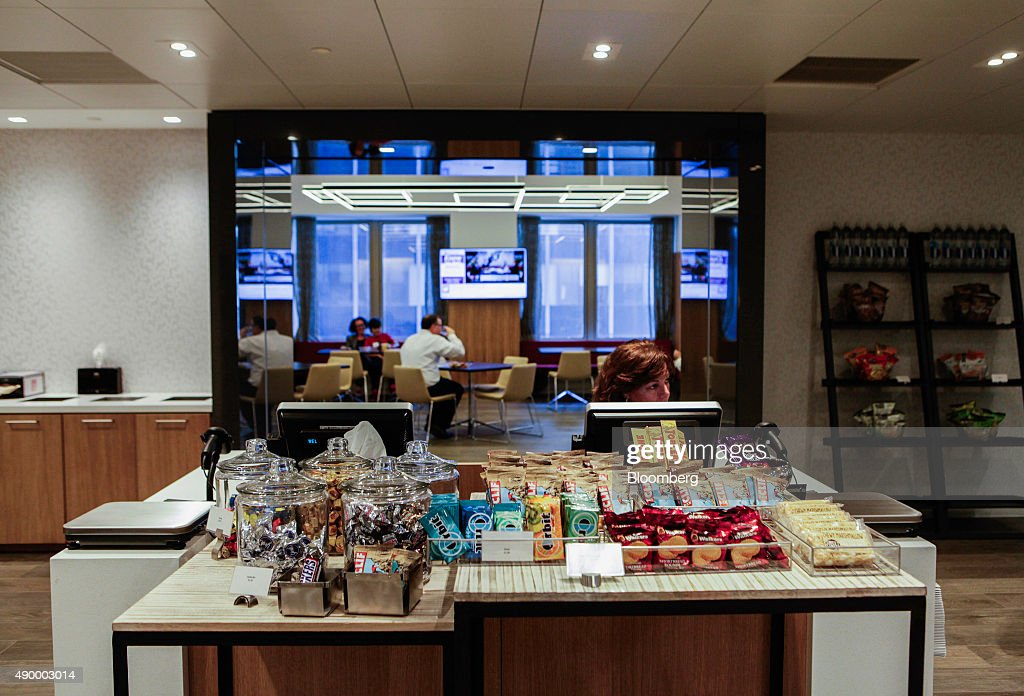 An employee waits at the register during lunch in the cafeteria of the Societe Generale SA in New York, U.S., on Monday, Sept. 14, 2015. Many of Wall Street's biggest banks have revamped their dining facilities in recent years, adding copious amounts of salad and partnering with local businesses to provide a smorgasbord of organic offerings. Photographer: Chris Goodney/Bloomberg via Getty Images