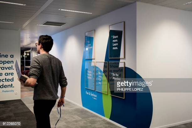 An employee walk in the lobby of BlaBlaCar headquarters in Paris on January 30 2018 The carpool platform BlaBlaCar will multiply the travel options...
