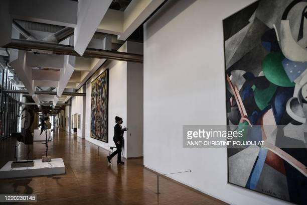 An employee walks at the Centre Georges Pompidou modern art museum, currently closed to the public, on June 15, 2020 in Paris, aimed to be reopen on...