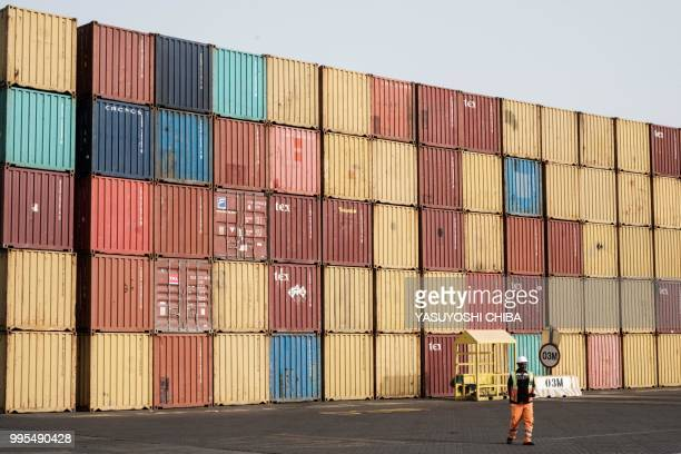 An employee walks at the Doraleh Container Terminal in Djibouti on July 4 2018 East Africa's smallest country Djibouti launched on July 5 the first...