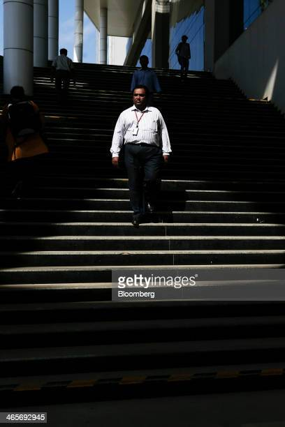 An employee walks down a staircase outside a building in the Wipro Ltd campus in Bangalore India on Tuesday Jan 28 2014 Worldwide spending on...