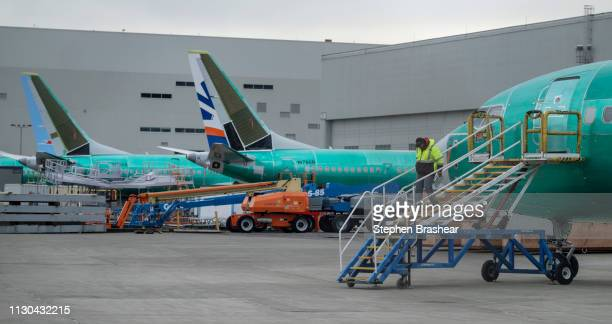 An employee walks down a stairway leading to a Boeing 737 MAX airplane on March 14 2019 in Renton Washington The 737 MAX Boeing's newest model has...