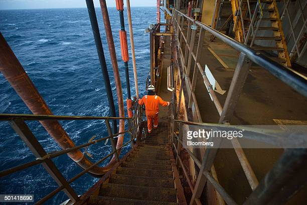 An employee walks down stairs on the Armada gas condensate platform operated by BG Group Plc in the North Sea off the coast of Aberdeen UK on...