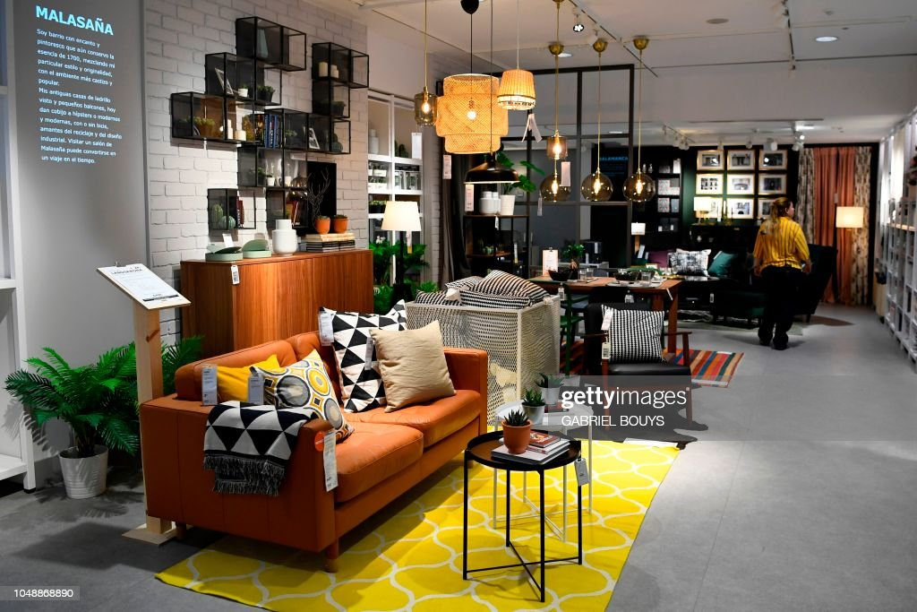 An Employee Walks In A Store Of The Swedish Furniture Giant Ikea In