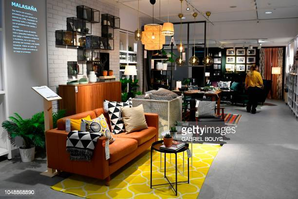 An employee walks in a store of the Swedish furniture giant Ikea in Madrid city center on October 10, 2018.
